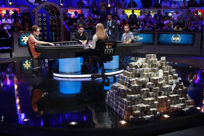 From left, Christoph Vogelsang, Daniel Colman and Daniel Negreanu play during the final table of the Big One For One Drop tournament at the World Series of Poker Tuesday, July 1, 2014 at the Rio. Colman took home first place and $15,306,668 in prize money.