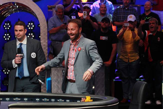 Daniel Negreanu reacts after drawing a Jack, Ace and 4 on the flop for his Ace and 4 during the final table of the Big One For One Drop tournament at the World Series of Poker Tuesday, July 1, 2014 at the Rio. Daniel Colman took home first place and $15,306,668 in prize money.