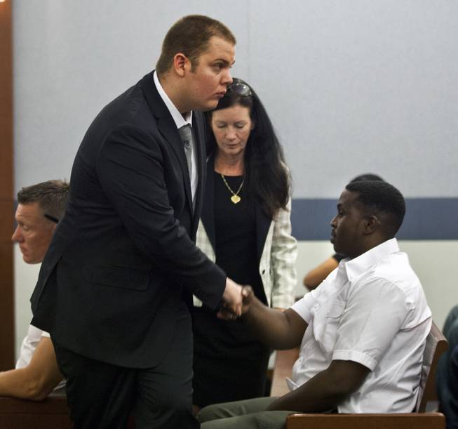 Jim Edward Johnson, who told police he accidentally shot his friend while filming a rap video at the Palms, shakes a man's hand after appearing in Justice Court for a prelim hearing on Tuesday, July 1, 2014.  L.E. Baskow