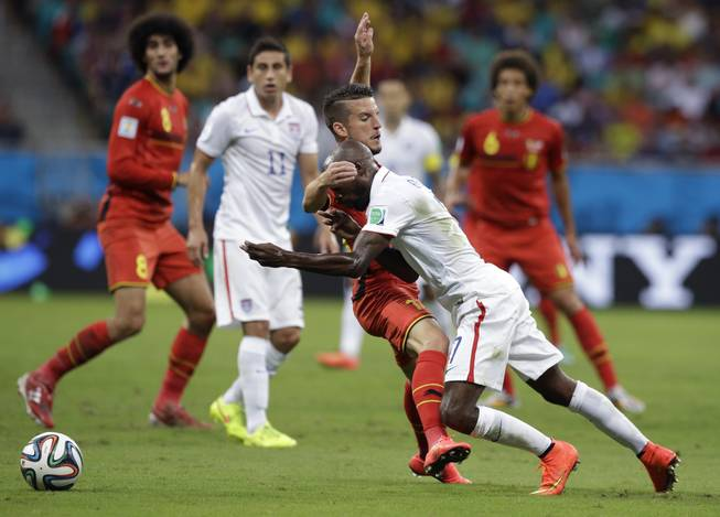 DaMarcus Beasley, right, of the United States is challenged by Belgium's Toby Alderweireld during the World Cup Round of 16 soccer match between Belgium and the USA at Arena Fonte Nova on Tuesday, July 1, 2014, in Salvador, Brazil.