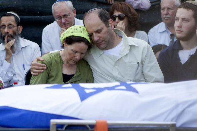 Avi and Rachel Fraenkel embrace during the funeral of their son, Naftali, a 16-year-old with dual Israeli-American citizenship, in the West Bank Jewish settlement of Nof Ayalon, Tuesday, July 1, 2014.