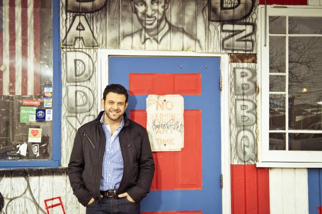 "This undated photo provided by the Travel Channel shows host Adam Richman of the new series ""Man Finds Food"" in Atlanta. The channel said Tuesday, July 1, 2014, that Richman's show has been postponed indefinitely but didn't explain why. ""Man Finds Food"" was to debut Wednesday."