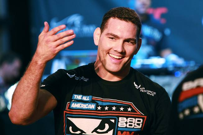 Chris Weidman gestures to fans during the open workout for UFC 175 Wednesday, July 2, 2014 at the Fashion Show Mall.