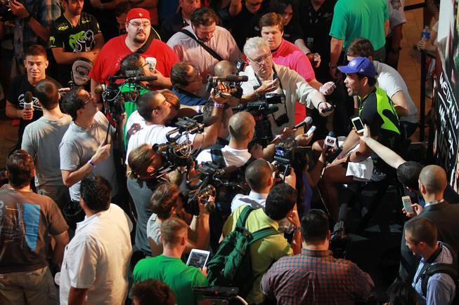 Lyoto Machida speaks to reporters during the open workout for UFC 175 Wednesday, July 2, 2014 at the Fashion Show Mall.