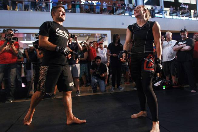 Alexis Davis and Flavio Meier laugh during the open workout for UFC 175 on Wednesday, July 2, 2014, at Fashion Show Mall.