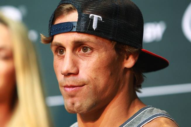 Urijah Faber looks out towards fans during the open workout for UFC 175 Wednesday, July 2, 2014 at the Fashion Show Mall.