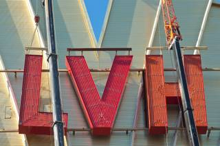 Yesco sets up large cranes in preparation to remove the LVH letters off the main sign of Westgate's newly purchased property, formerly the Las Vegas Hotel, Tuesday July 1, 2014.