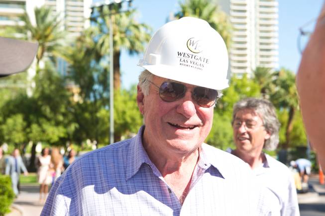 David Siegel, Founder and CEO of Westgate Resorts, smiles after being hoisted up over 200 feet to remove the LVH letters off the main sign of Westgate's newly purchased property, Tuesday July 1, 2014.