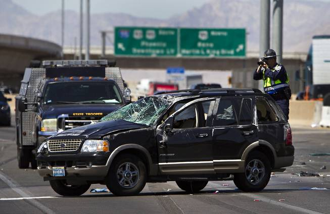 Metro Police work the scene of a fatal crash on Interstate 15,  just north of the U.S. 95 interchange, on Wednesday, July 2, 2014.