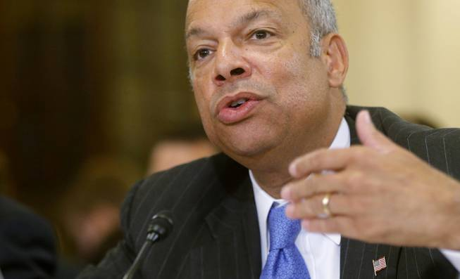 In this June 24, 2014, file photo, Homeland Security Secretary Jeh Johnson testifies on Capitol Hill in Washington. Johnson is ordering increased security measures at some overseas airports offering direct flights to the United States.