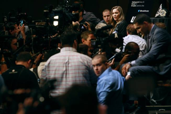 UFC women's bantamweight champion Ronda Rousey is surrounded by cameras and reporters during a media availability in advance of UFC 175 Thursday, July 3, 2014 at Mandalay Bay.