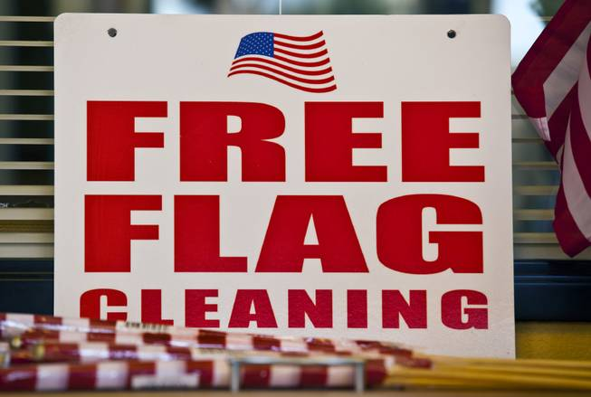 Mahamed Youssouf as owner of the Green Cleaners Alteration Center is giving away 500 flags and cleaning flags for free in honor of the Fourth of July on Wednesday, July 3, 2014.