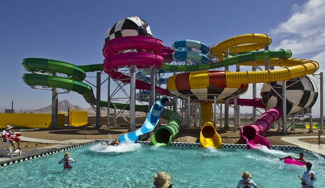 Many of the water slides are in operation during opening day at Cowabunga Bay, the new water park in Henderson with over 25 rides & attractions on Friday, July 4, 2014.  L.E. Baskow