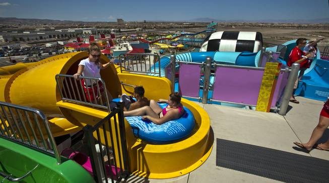 Attendees at the top of a water slide on opening day at Cowabunga Bay, the new water park in Henderson with over 25 rides & attractions on Friday, July 4, 2014.  L.E. Baskow