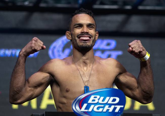 Bantamweight Rob Font flexes with tongue out during the UFC 175 weigh ins at the Mandalay Bay Resort on Friday, July 4, 2014.