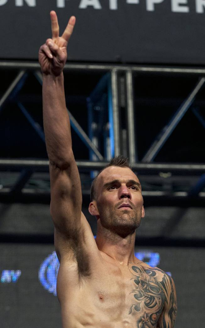 Bantamweight George Roop salutes the fans during the UFC 175 weigh ins at the Mandalay Bay Resort on Friday, July 4, 2014.