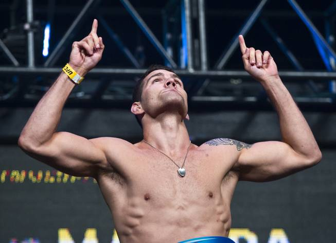 World Middleweight Champion Chris Weidman points to the heavens during the UFC 175 weigh ins at the Mandalay Bay Resort on Friday, July 4, 2014.