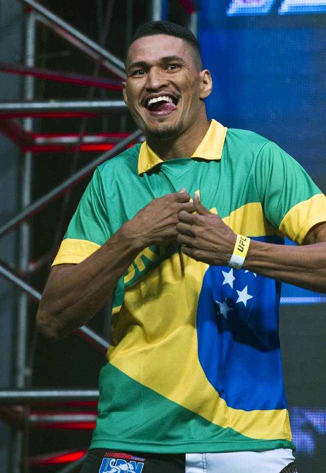 Welterweight Idlemar Alcantara enters wearing a Brazil soccer jersey during the UFC 175 weigh ins at the Mandalay Bay Resort on Friday, July 4, 2014.