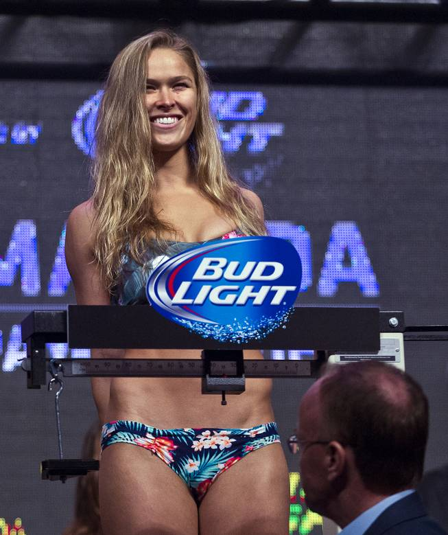Bantamweight Ronda Rousey smiles to her fans during the UFC 175 weigh ins at the Mandalay Bay Resort on Friday, July 4, 2014.