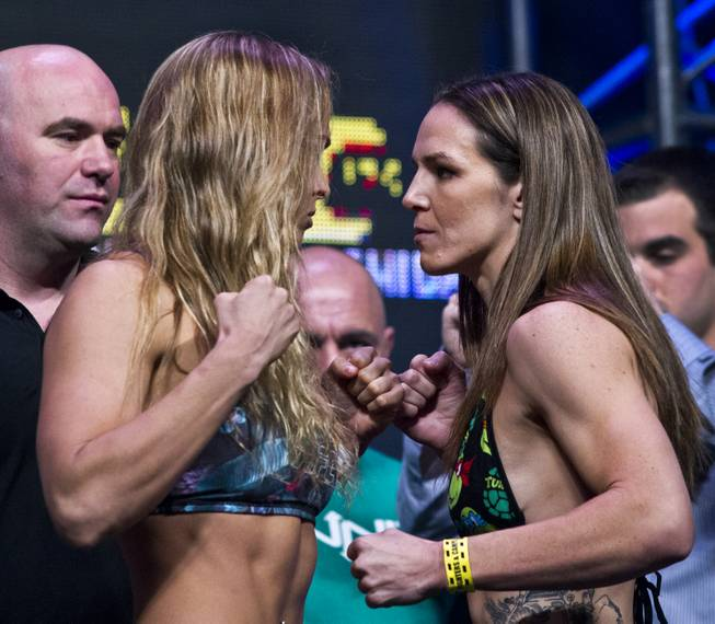 Ronda Rousey and Alexis Davis square off during UFC 175 weigh-ins at the Mandalay Bay on Friday, July 4, 2014.