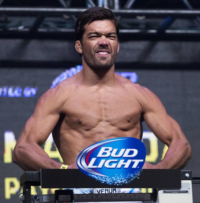 World Middleweight Championship contender Lyoto Machida flexes during the UFC 175 weigh ins at the Mandalay Bay Resort on Friday, July 4, 2014.