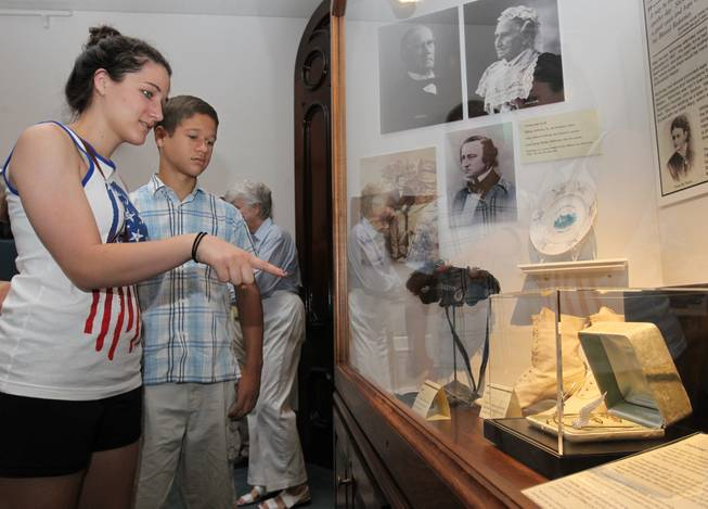 Lexie Yut 17, and Nico Yut 14 of Dallas look at the Ida McKinley tiara on public display at the William McKinley Presidential Library and Museum on Wednesday, July 2, 2014 in Canton, Ohio.