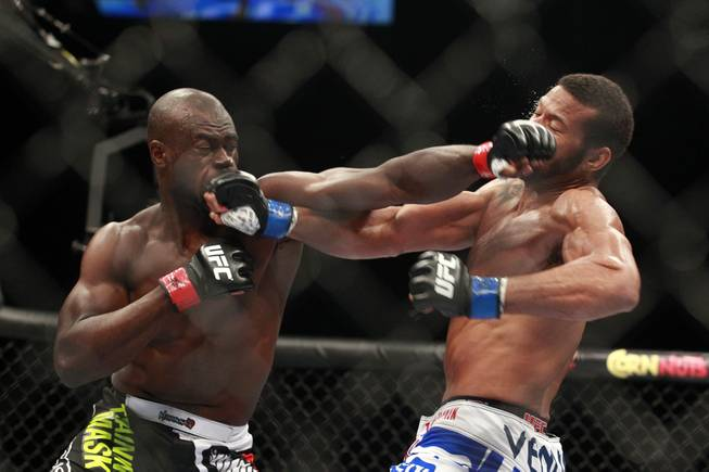 Uriah Hall, left, and Thiago Santos trade punches during their fight at UFC 175 at the Mandalay Bay Events Center Saturday, July 5, 2014. Hall won by decision.