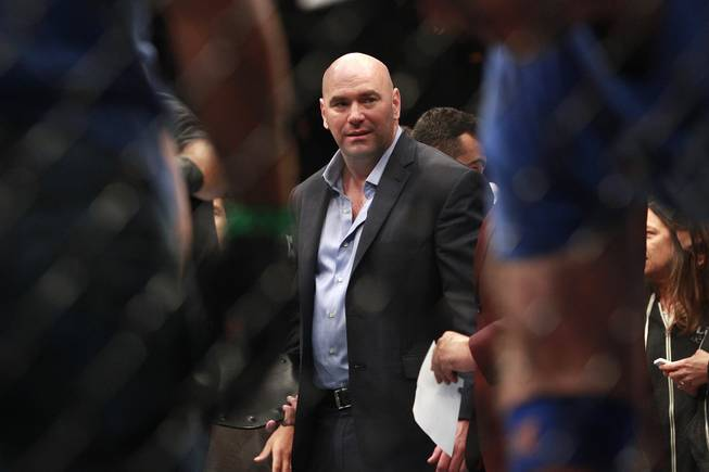 Dana White is seen in the octagon after Ronda Rousey's TKO of Alexis Davis at UFC 175 at the Mandalay Bay Events Center Saturday, July 5, 2014. Rousey retained her title with a 16-second TKO.
