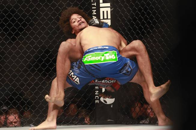 Urijah Faber throws Alex Caceres during their fight at UFC 175 at the Mandalay Bay Events Center Saturday, July 5, 2014. Faber won by submission in the third round.