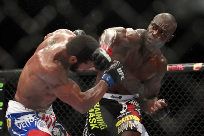 Uriah Hall hits Thiago Santos with a right during their fight at UFC 175 at the Mandalay Bay Events Center Saturday, July 5, 2014. Hall won by decision.