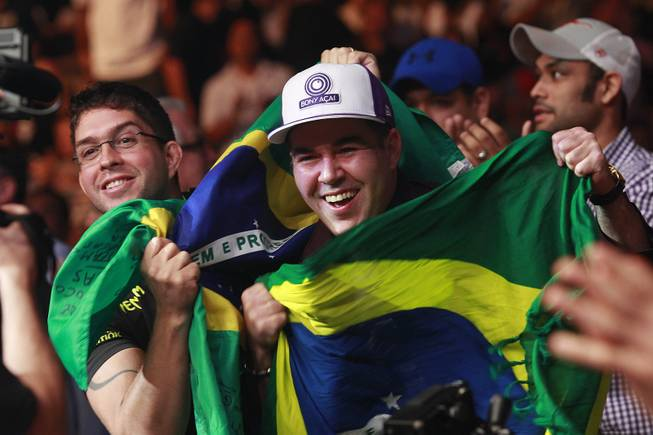 Fans of Lyoto Machida wave a Brazilian flag during his fight against Chris Weidman at UFC 175 at the Mandalay Bay Events Center Saturday, July 5, 2014. Weidman won a unanimous decision to retain his middleweight belt.