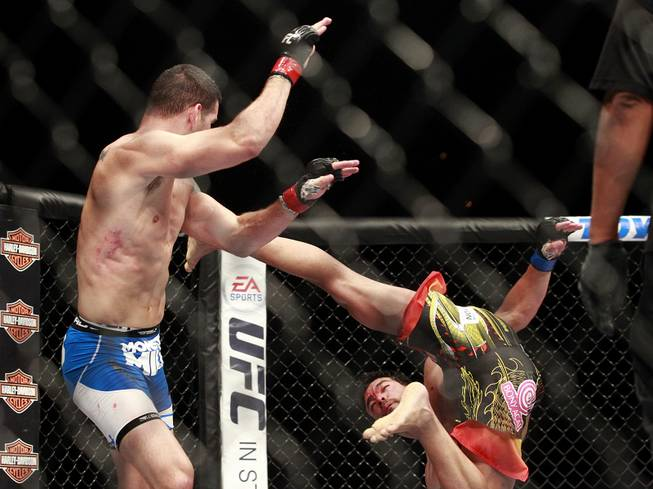 Lyoto Machida misses Chris Weidman with a flying kick during their fight at UFC 175 at the Mandalay Bay Events Center Saturday, July 5, 2014. Weidman won a unanimous decision to retain his middleweight belt.