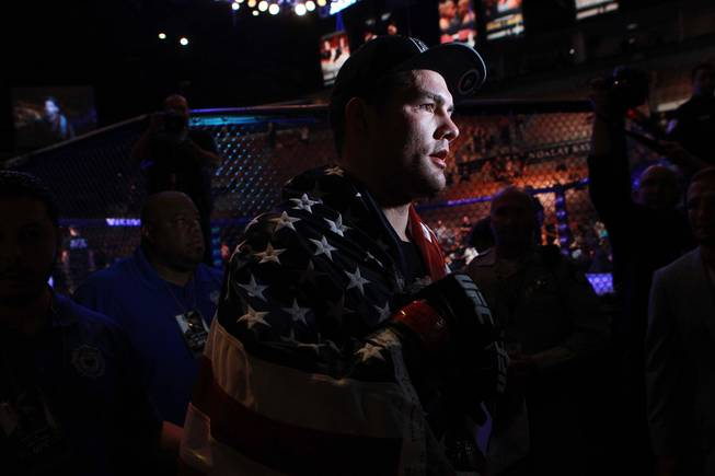 Chris Weidman leaves the arena after his fight against Lyoto Machida at UFC 175 at the Mandalay Bay Events Center Saturday, July 5, 2014. Weidman won a unanimous decision to retain his middleweight belt.