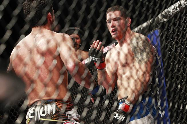 Chris Weidman beckons Lyoto Machida towards him during their fight at UFC 175 at the Mandalay Bay Events Center Saturday, July 5, 2014. Weidman won a unanimous decision to retain his middleweight belt.
