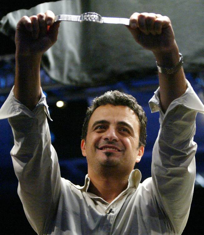 Australia's Joe Hachem holds the championship bracelet as he celebrates winning the World Series of Poker Main Event on Saturday, July, 16, 2005, at Binion's Gambling Hall and Hotel in Las Vegas after a final that lasted almost 14 hours.