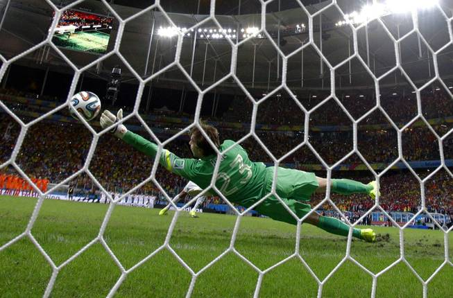 Netherlands goalkeeper Tim Krul makes a save on a shot by Costa Rica's Michael Umana during a penalty shootout at the Arena Fonte Nova in Salvador, Brazil, on Saturday, July 5, 2014. The Netherlands defeated Costa Rica 4-3 in penalties after a 0-0 tie.