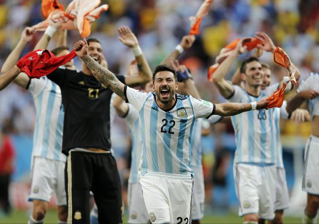 Argentina's Ezequiel Lavezzi and teammates celebrate at the end of the World Cup quarterfinal match between Argentina and Belgium at the Estadio Nacional in Brasilia, Brazil, on Saturday, July 5, 2014. Argentina won 1-0.