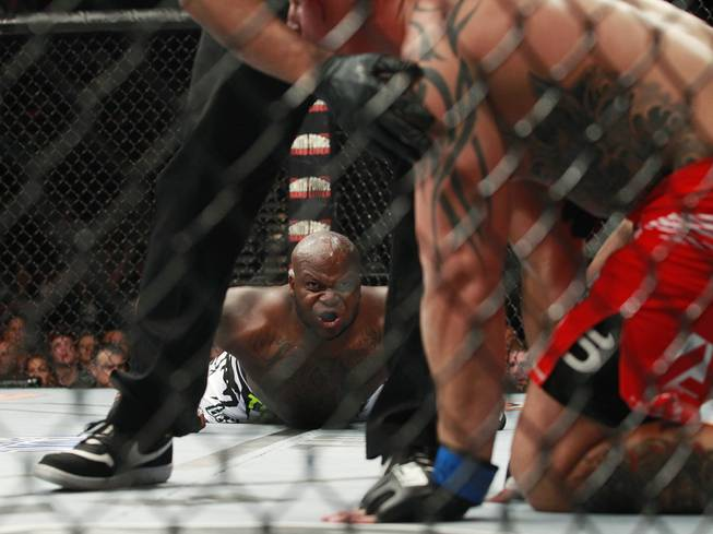 Derrick Lewis stares at Guto Inocente after knocking him out in the first round of their fight at The Ultimate Fighter 19 Finale Sunday, July 6, 2014 at the Mandalay Bay Events Center.
