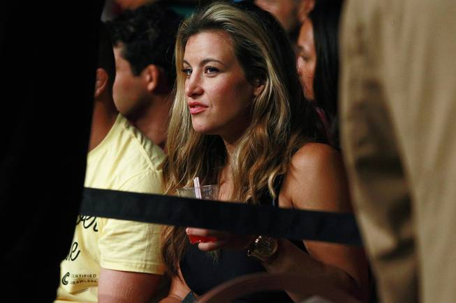 "Misha Tate watches the action at ""The Ultimate Fighter"" 19 finale Sunday, July 6, 2014 at the Mandalay Bay Events Center."
