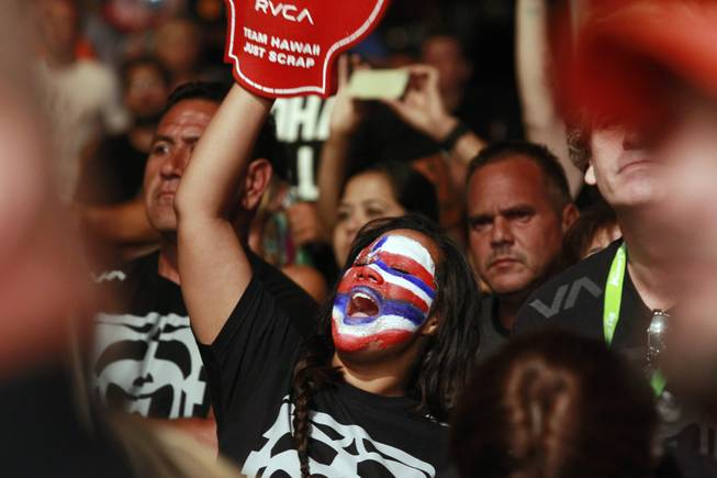 "A B.J. Penn fan cheers as he makes his entrance for his  fight against Frankie Edgar at ""The Ultimate Fighter"" 19 finale Sunday, July 6, 2014 at the Mandalay Bay Events Center."