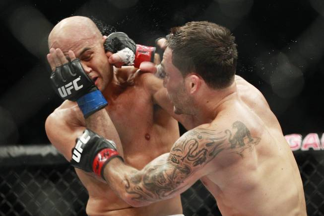 "Frankie Edgar hits B.J. Penn with a right during their fight at ""The Ultimate Fighter"" 19 finale Sunday, July 6, 2014 at the Mandalay Bay Events Center."