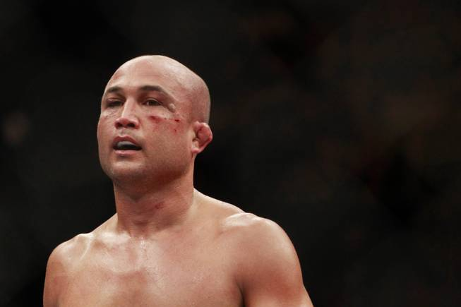 "With a welt developing under his eye, B.J. Penn heads to his corner between rounds of his fight against Frankie Edgar at ""The Ultimate Fighter"" 19 finale Sunday, July 6, 2014 at the Mandalay Bay Events Center."