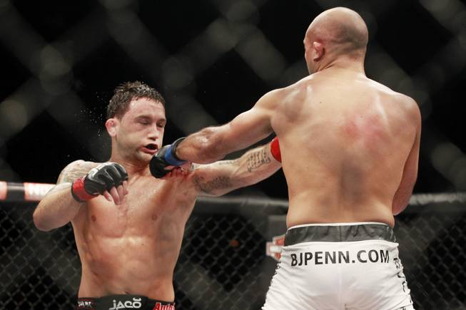 "Frankie Edgar is hit by a left from B.J. Penn during their fight at ""The Ultimate Fighter"" 19 finale Sunday, July 6, 2014 at the Mandalay Bay Events Center."