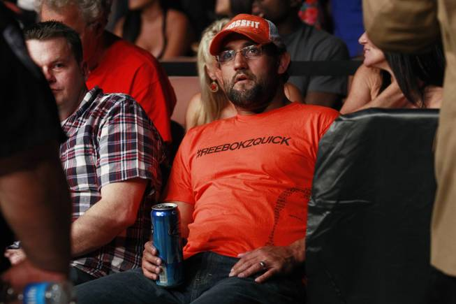 "UFC welterweight champion Johnny Hendricks watches the Frankie Edgar vs. B.J. Penn fight at ""The Ultimate Fighter"" 19 finale Sunday, July 6, 2014 at the Mandalay Bay Events Center."