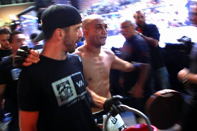"B.J. Penn exits the arena after being defeated by Frankie Edgar at ""The Ultimate Fighter"" 19 finale Sunday, July 6, 2014 at the Mandalay Bay Events Center."