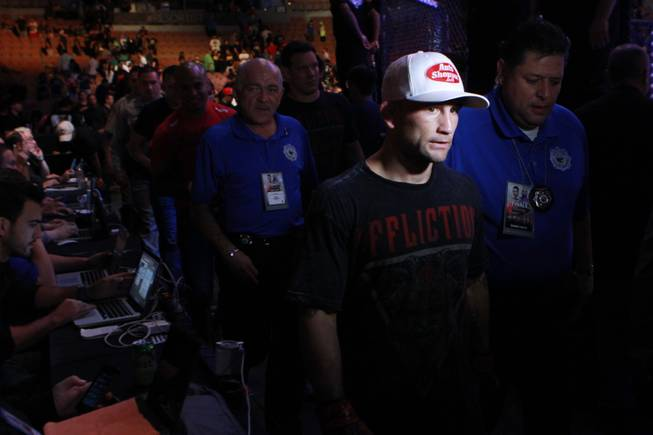 "Frankie Edgar exits the arena after notching a third round TKO of B.J. Penn at ""The Ultimate Fighter"" 19 finale Sunday, July 6, 2014 at the Mandalay Bay Events Center."