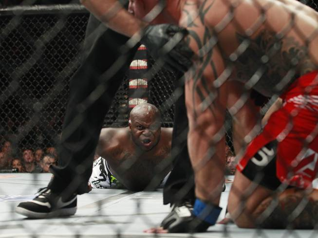 Derrick Lewis stares at Guto Inocente after knocking him out in the first round of their fight at The Ultimate Fighter 19 Finale Sunday, July 19, 2014 at the Mandalay Bay Events Center.