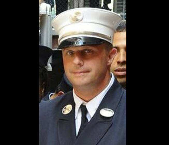 This photo taken on June 26, 2014, and released by the NYFD, shows Lt. Gordon Ambelas, who died at a hospital late Saturday night, July 5, 2014, after battling a blaze that broke out on an upper floor of a Brooklyn public-housing high-rise in New York. Two other firefighters were taken to Bellevue Hospital with minor injuries, and two civilians were treated for minor injuries at area hospitals.