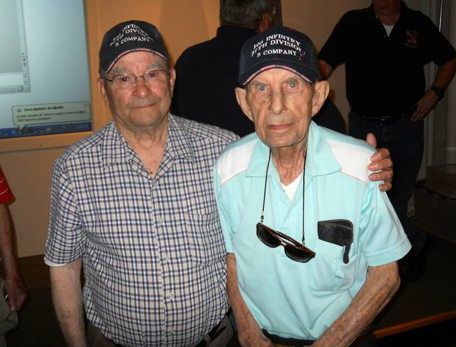 "World War II veterans Wilfred ""Spike"" Mailloux, left, and John Sidur, both of Cohoes, N.Y., pose at a presentation on the 70th anniversary of the Battle of Saipan at the New York State Military Museum on June 7, 2014, in Saratoga Springs, N.Y. Both served on Saipan with the U.S. Army's 27th Infantry Division, 105th Infantry Regiment. The Army's 27th Infantry Division bore the brunt of Japan's largest mass suicide attack, launched before dawn on July 7, 1944, on the island of Saipan. The division's 105th Regiment saw more than 400 killed and 500 wounded during the attack by more than 3,000 Japanese soldiers and sailors. The 27th was a former New York National Guard unit that still had many New Yorkers among its ranks when it landed on Saipan after the U.S. Marines made the initial beach assault on June 15, 1944."