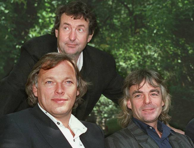 Members of the rock group Pink Floyd, from left, David Gilmour, Nick Mason and Richard Wright, are shown in this 1988 photo.